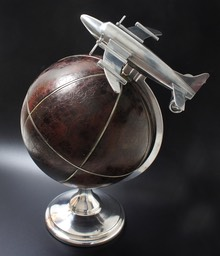 Large aviation theme leather globe and plane on stand
